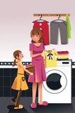 Mother daughter doing  laundry Stock Photography