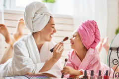 Mother and daughter are doing make up Royalty Free Stock Images