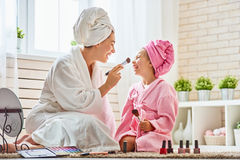 Mother and daughter are doing make up Royalty Free Stock Image