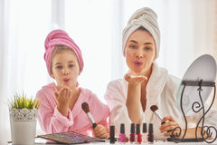 Mother and daughter are doing make up Stock Images