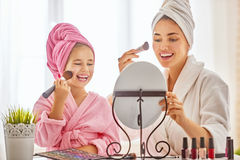 Mother and daughter are doing make up Royalty Free Stock Photo