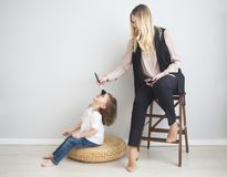 Mother and daughter doing make up oto each other Stock Images