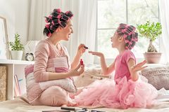 Mother and daughter are doing manicures Royalty Free Stock Photography