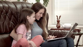 Mother and daughter doing online shopping stock footage
