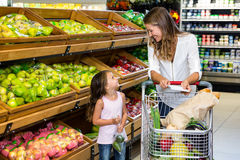 Mother and daughter doing shopping stock photography