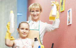 Mother and Daughter doing Tidy Up Together Royalty Free Stock Photo