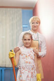 Mother and Daughter doing Tidy Up Together Stock Image