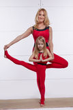 Mother and daughter doing yoga exercise, fitness, gym sports pai Royalty Free Stock Image