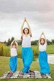 Mother with daughter doing yoga exercise Stock Photography