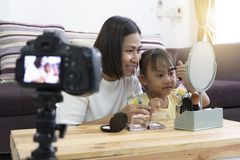 Mother and daughter doing your makeup. With recording making video stock photography