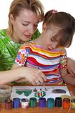 Mother and the daughter draw Stock Photography