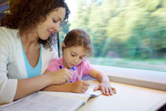 Mother and daughter draw in magazine Stock Photos