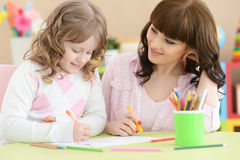 Mother and daughter draw. At the table Royalty Free Stock Photos