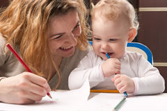 Mother and daughter drawing Stock Photos