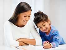 Mother and daughter drawing Royalty Free Stock Photography
