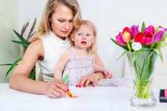 Mother and daughter drawing a picture Stock Photos