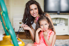Mother and daughter drawing in the room. Royalty Free Stock Photography