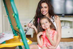 Mother and daughter drawing in the room. Royalty Free Stock Photos
