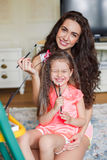 Mother and daughter drawing in the room. Royalty Free Stock Images