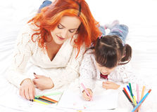 A redhead Caucasian mother and a little daughter relaxing Royalty Free Stock Photos
