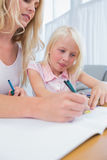 Mother and daughter drawing at the table Royalty Free Stock Photo