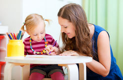 Mother and daughter drawing together Royalty Free Stock Photography