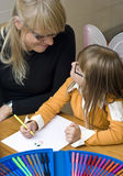 Mother and daughter drawing together Royalty Free Stock Photos