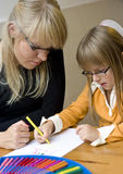 Mother and daughter drawing together Stock Image