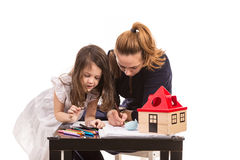 Mother and daughter drawing together Stock Photography