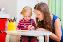 Mother and daughter drawing together Stock Photo