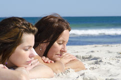 Mother and Daughter dreaming at beach Royalty Free Stock Photos