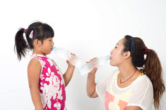 Mother daughter drink Stock Image