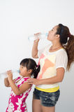 Mother daughter drink Royalty Free Stock Images