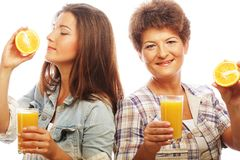 Mother and daughter drinking orange juice Royalty Free Stock Image