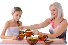 Mother and daughter drinking tea Stock Images