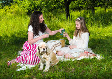 Mother and daughter drinking water. In the park royalty free stock images