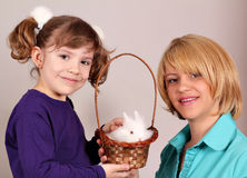 Mother and daughter with dwarf rabbit Royalty Free Stock Photo