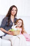 Mother and daughter with the Easter bunny Stock Image