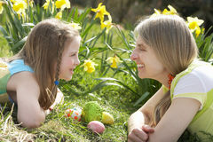 Mother And Daughter On Easter Egg Hunt stock photo