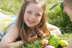 Mother And Daughter On Easter Egg Hunt royalty free stock photo