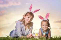 Mother and daughter with easter eggs stock photos
