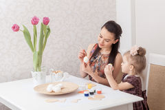 Mother and daughter with Easter eggs Stock Photography