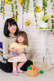 Mother and daughter in easter interior stock photo