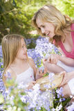 Mother and daughter  Easter looking for eggs Royalty Free Stock Photography