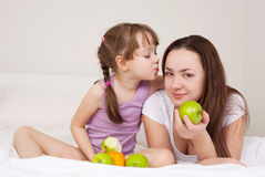Mother and daughter eat apples Royalty Free Stock Images