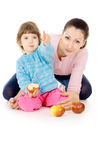 Mother and daughter eat apples Royalty Free Stock Image