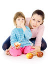 Mother and daughter eat apples Royalty Free Stock Photo