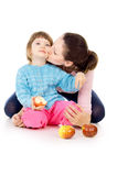 Mother and daughter eat apples Stock Image