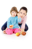 Mother and daughter eat apples Stock Photo