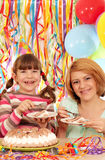 Mother and daughter eat birthday cake Royalty Free Stock Image